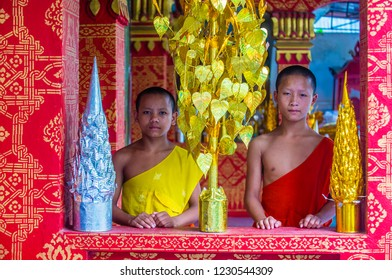 LUANG PRABANG , LAOS - AUG 12 2018 : Novice monks in Luang Prabang Laos on August 12 2018. It is estimated that about 1 in 3 male Laotians join a monastery at least for a while
