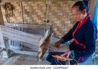 LUANG PRABANG , LAOS - AUG 14 : Laotian weaver in a village near Luang Prabang Laos on August 14 2018. nearly 70 percent of the population in Laos lives in villages