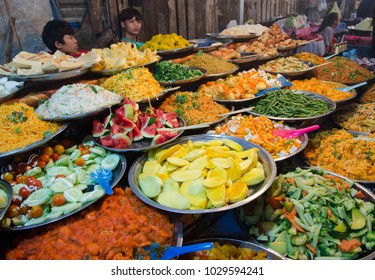 LUANG PRABANG, LAOS - AUGUST 16 2017: Young boys are selling local food during night market in Luang Prabang.