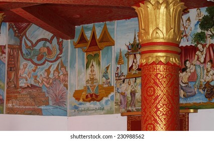 LUANG PRABANG, LAOS - AUGUST 16: Paintings of the cycle of life and the consequences of bad behaviour in the next life on the walls of a Buddhist temple in Luang Prabang, Laos on the 16th August 2014
