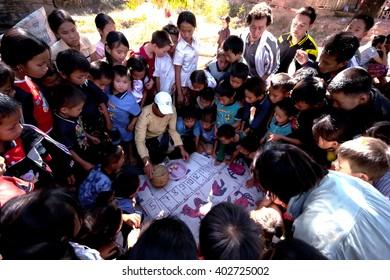 Luang Prabang, Laos - December 31, 2005 : Gambling dice in the village on the way to Luang Prabang .