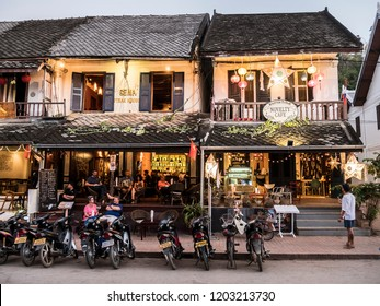 Luang Prabang, Laos - January 23, 2018: Shops and restaurants on the main road of Luang Prabang, Laos