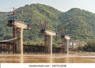 LUANG PRABANG, LAOS - JANUARY 30, 2019: A new bridge across the Mekong River in Luang Prabang, the UNESCO-listed city in northern Laos, as part of the new Trans-Asian Railway network.