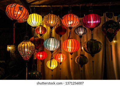 LUANG PRABANG, LAOS - March 2019: Traditional Lao style hotel with Chinese lanterns decoration in Luang Prabang, Laos. Chinese lanterns lit by the evening, Laos
