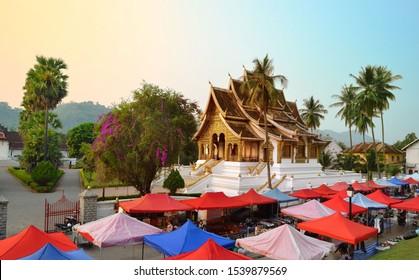 LUANG PRABANG, LAOS - MARCH 23, 2018: The Haw Pra Bang Temple near Royal Palace of Luang Prabang National museum with night market