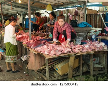 luang prabang, laos - november 20, 2018: meat is offered for sale at the market in luang prabang.