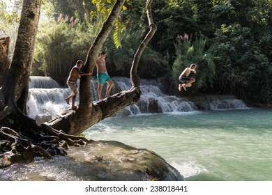 LUANG PRABANG, LAOS - OCTOBER 18 : Travelers jumping The Kuang Si Falls in Luang Prabang, Laos on October 18, 2014. Kuang Si Waterfall is the biggest in the Luang Prabang.