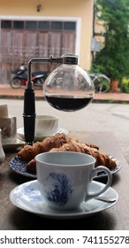 Luang Prabang, Laos - October 18th, 2017: Street view from a cafe in the town center of traditional percolated Laos coffee in a pot served with croissants.