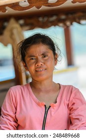 LUANG PRABANG, LAOS - SEP 25, 2014: Unidentified Lao woman in a pink blooze. 55% of Laos people belong to the Lao ethnic group
