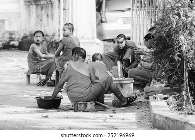 LUANG PRABANG, LAOS - SEP 25, 2014: Unidentified Lao Buddha monks. 55% of Laos people belong to the Lao ethnic group
