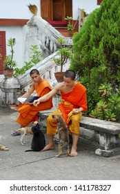 LUANG PRABANG, LAOS - SEPTEMBER 5: Unidentified monks in Wat Mai temple on September 5, 2011, in Luang Prabang, Laos. about 60% of the population of Laos practice Theravada Buddhism.