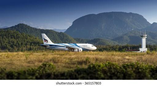 LUANG PRABANG,LAO PDR. - NOVEMBER 9 2015: Bangkok Airways - HS-PPB Airbus A319 landing at Luang Prabang International Airport from Suvarnnabhumi International Airport, Bangkok, Thailand