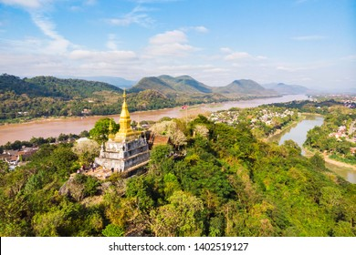 Luang Prang Laos View. Mount Phousi. South East Asia, View of town and surrounding countryside. golden pagoda of Wat Chom Si on the top of Mount Phou Si