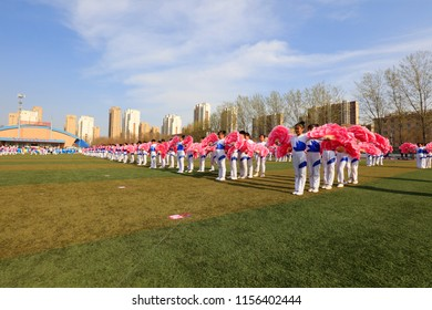 Luannan County - April 11, 2018: Primary and middle school students' spring track and field gymnastics group Gymnastics, Luannan, Hebei, China.