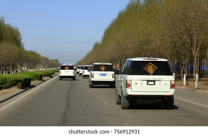 Luannan County - April 14, 2016: white Land Rover racing on the highway, Luannan, Hebei, China