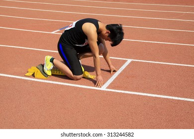 LUANNAN COUNTY - APRIL 14: short distance runner ready to start, April 14, 2015, Luannan County, Hebei Province, China