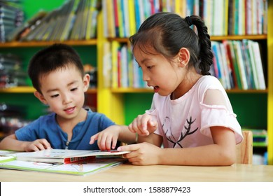 Luannan County, China - July 15, 2019: Two children are reading in the bookstore, Luannan County, Hebei Province, China