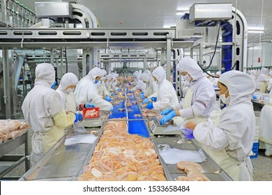Luannan County, China - June 18, 2019: Workers are busy on the broiler processing line, Luannan County, Hebei Province, China