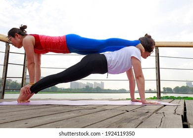 LUANNAN COUNTY, China - June 30, 2018: Women are practicing outdoor yoga in a park, LUANNAN COUNTY, Hebei Province, China