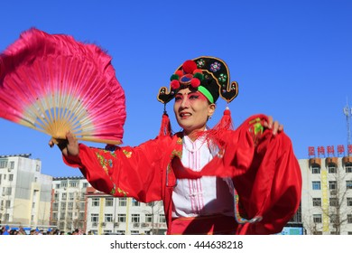 Luannan County- February 17: Chinese traditional style yangko folk dance performance in the street, on February 17, 2016, luannan County, hebei Province, China
