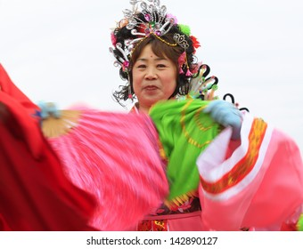LUANNAN COUNTY - FEBRUARY 25: During the Chinese Lunar New Year, people wear colorful clothes, yangko dance performances in the streets, on February 25, 2013, Luannan County, Hebei Province, China.