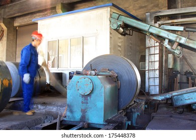 Luannan County, Hebei Province, November 19: Workers are busy working in production workshop, at Huifeng Steel Corp, on November 19, 2012. This is a large steel manufacturer in the local.