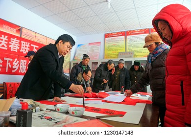 Luannan County - January 19, 2017: Several calligraphers are writing Spring Festival couplets in the room, Luannan County, Hebei Province, China.