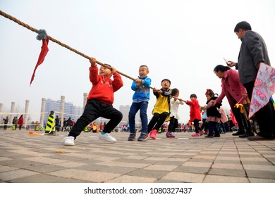 Luannan County - March 31, 2018: People are doing the outdoors tug of war games, Luannan, Hebei, China.