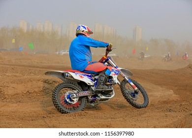 Luannan County - March 31, 2018: Cross-country motorbike field endurance race, Luannan County, Hebei Province, China