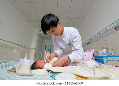 Luannan County - May 11, 2018: Pediatric nurses take care of newborns, Luannan County, Hebei, China