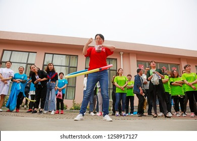 Luannan County - May 11, 2018: Hula hoop race in the outdoors, Luannan County, Hebei, China