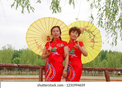Luannan County - May 17, 2018: cheongsam lady in the park, Luannan County, Hebei Province, China