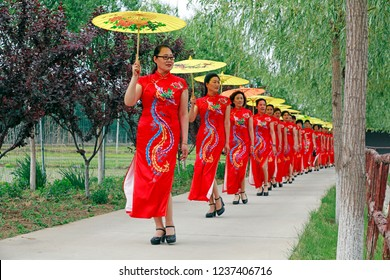 Luannan County - May 18, 2018: Chinese cheongsam shows in the park, Luannan County, Hebei Province, China