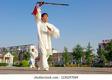 Luannan County - May 19, 2018: Chinese Taiji Sword performance on the square, Luannan County, Hebei Province, China