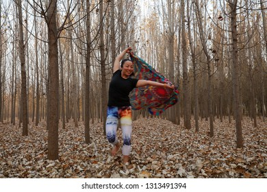 Luannan County - November 11th, 2018: A lady was playing in the park grove, Luannan County, Hebei Province, China