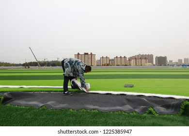 LUANNAN COUNTY - Oct. 15, 2018: Artificial lawn laying site in a sports field, Luannan County, Hebei Province, China