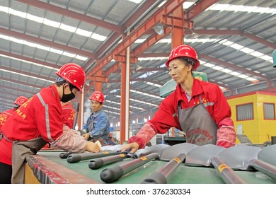 Luannan County - October 16: workers were packing steel spade on the production line, on October 16, 2015, luannan county, hebei province, China