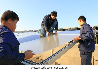 Luannan - December 11, 2015: Engineering and technical personnel to install solar photovoltaic glass, Luannan, Hebei, China, December 11, 2015