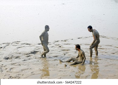 Luannan - July 26: visitors taking bath in the muddy tidal flats, on July 26, 2015, luannan county, hebei province, China