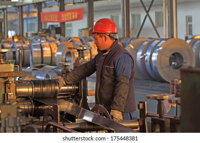Luannan, November 19: A worker operating the machine, in Huifeng Steel Corp workshop, in November 19, 2012.