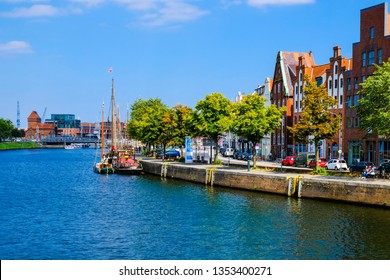 LUBECK, GERMANY - AUGUST 16, 2018: Embankment of the Trave river with yachts in Old Town. Germany.