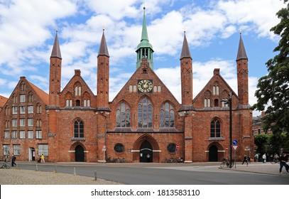 Lubeck, Germany - July 3, 2019: View of the Heiligen Geist Hospital on Koberg Platz in Lubeck, Germany on July 3, 2019