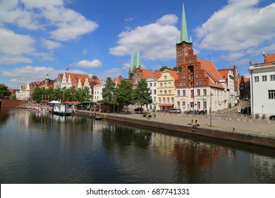 Lubeck, Germany - June, 27, 2017:  summer view of the Old Town pier architecture in Lubeck, Germany