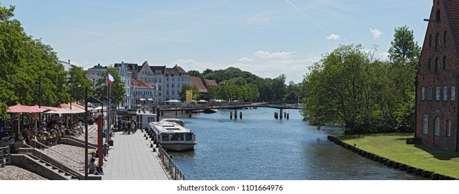 LUBECK, GERMANY - MAY 25, 2018:  panorama of the old town island with trave river, lubeck, germany