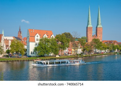 LUBECK, GERMANY - SEPTEMBER 16, 2014: Historical cityscape at the river Trave with cathedral in Lubeck at the Baltic Sea