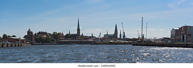 LUBECK, GERMANY-MAY 25; 2018: Panorama image of Hanseatic city of Luebeck with trave river, Luebeck, Germany