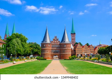Lubeck. The Holsten Gate or Holstentor on Holstentorplatz in old town, Germany. Translation: Harmony Within, Peace Without.