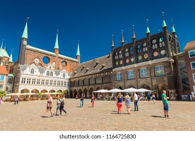 Lubeck - July 2018, Germany:  View of the central square of Lubeck and City Administration building. One of the most visited cities in northern Germany. Popular touristic destination