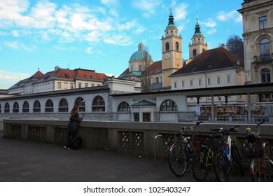 Lubiana / Slovenia - December 8, 2017: A girl looks a building in Lubiana, Lubiana, Slovenia