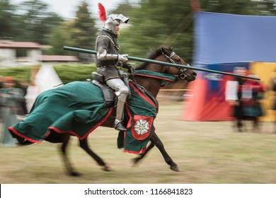 LUBIAZ, POLAND - AUGUST 25, 2018:  Monastery Siege - historical staging. Knights horse riding show.